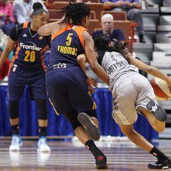 San Antonio Stars' Moriah Jefferson (4) dribbles past Connecticut Sun's Jasmine Thomas (5).