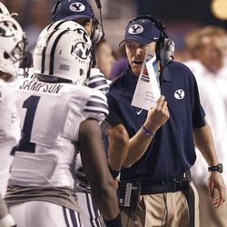 Head coach Bronco Mendenhall of the Brigham Young Cougars talks with players during NCAA football in Boise, Thursday, Sept. 20, 2012.