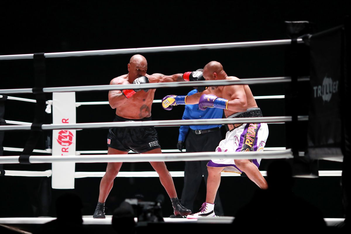 Mike Tyson throws a punch in the third round against Roy Jones Jr. during Mike Tyson vs Roy Jones Jr. presented by Triller at Staples Center on November 28, 2020 in Los Angeles, California.