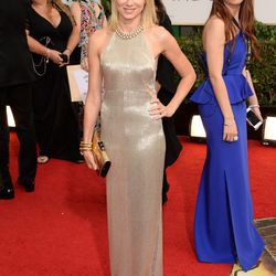 Naomi Watts in an embroidered white gold gown by Tom Ford.
