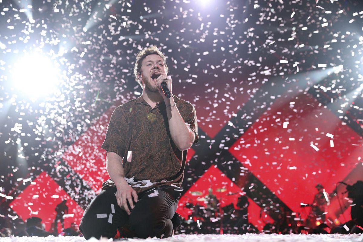 In this Feb. 1, 2018 file photo, Dan Reynolds, lead singer of Imagine Dragons, performs at the EA Sports Bowl in Minneapolis.  Omar Vega/Invision/AP, File