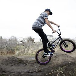 Cameron Tucker, 14, jumps his bike in West Jordan on Wednesday, Nov. 21, 2012. Utah lawmakers are pushing to add more physical activity in schools because being active increases brain function, according to a nationwide study called SPARK.