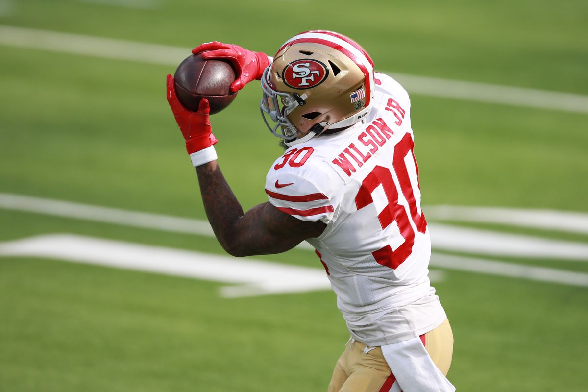 Jeff Wilson #30 of the San Francisco 49ers makes a catch before the game against the Los Angeles Rams at SoFi Stadium on November 29, 2020 in Inglewood, California.