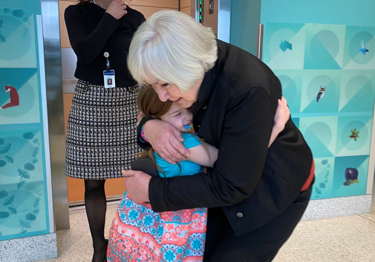 Gail Miller hugs Nellie Mainor, 9, who had a kidney transplant for dense deposit kidney disease and wanted to show Gail Miller around the dialysis clinic at Primary Children's Hospital in Salt Lake City after a press conference on Tuesday, Jan. 21, 2020. During the press conference, Intermountain Healthcare announced it will build an additional Primary Children's Hospital campus in Lehi. Gail Miller and the Miller family donated $50 million to the cause.