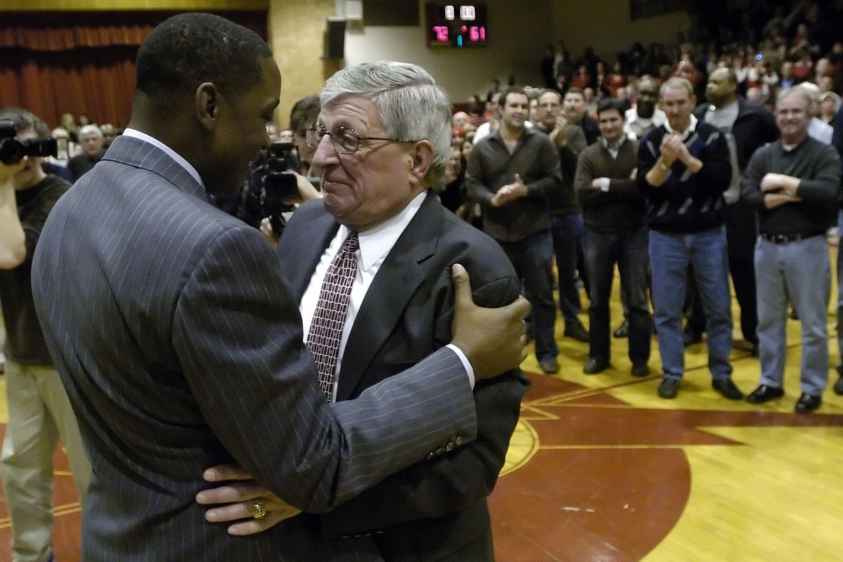 Former St. Joseph and NBA star Isiah Thomas embraces coach Gene Pingatore during a celebration in 2009.