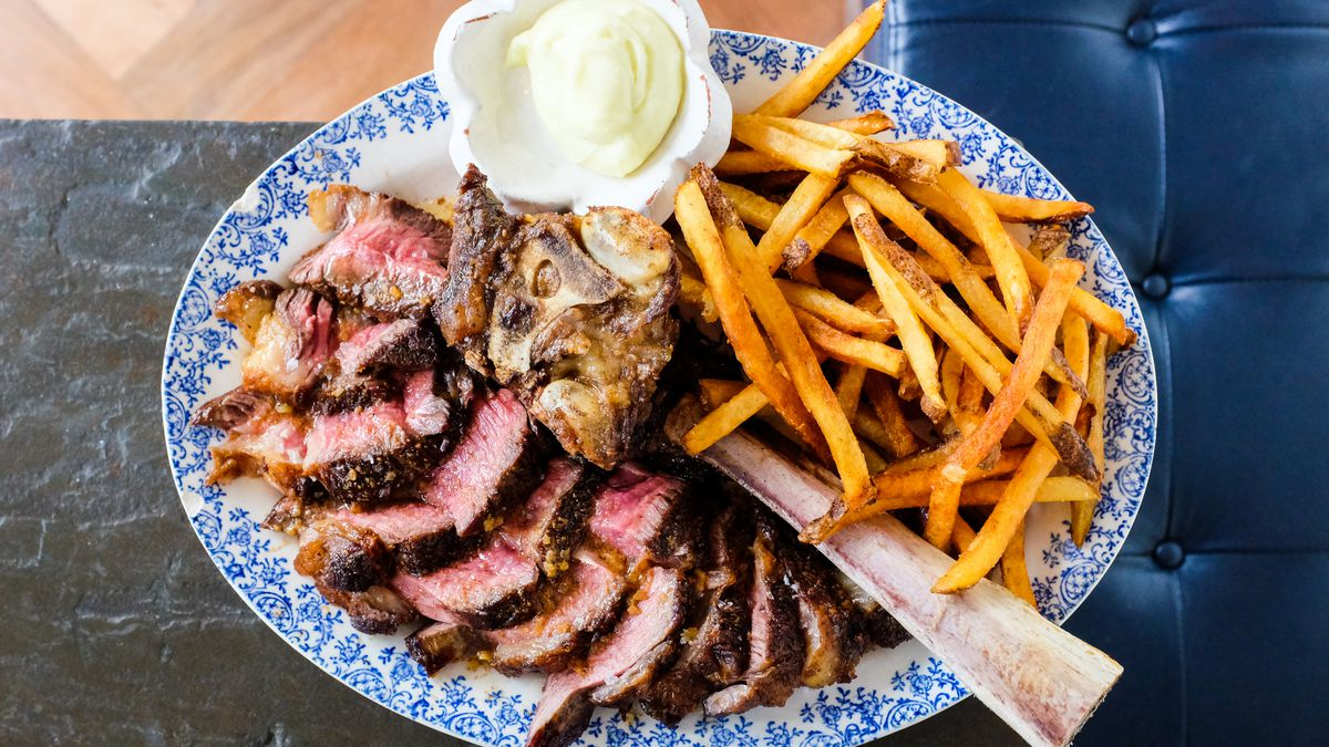 Bone In Chuck Eye Steak And Fries At Bateau Bill Addison Eater