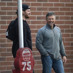 Former Ute and current Oakland Raider Tony Bergstrom jokes with Utah coach Kyle Whittingham as NFL hopefuls do drills for pro scouts during Utah pro football day at the University of Utah Wednesday, March 19, 2014, in Salt Lake City.