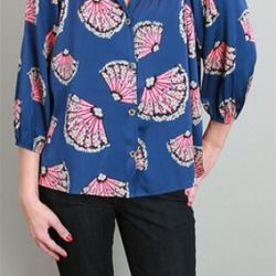 The Blue Moon Fan Blouse, Tucker, $294<br />Tucker defines effortless, 'easy breezy' style. We recommend pairing Tucker blouses with…anything! Tuck into jeans, wear loose over trouser pants, or look great at the office in Tucker and a high-waisted s