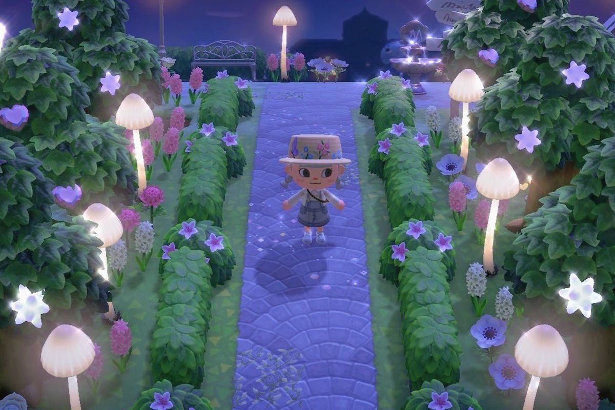 A villager in Animal Crossing stands next to star fragment trees