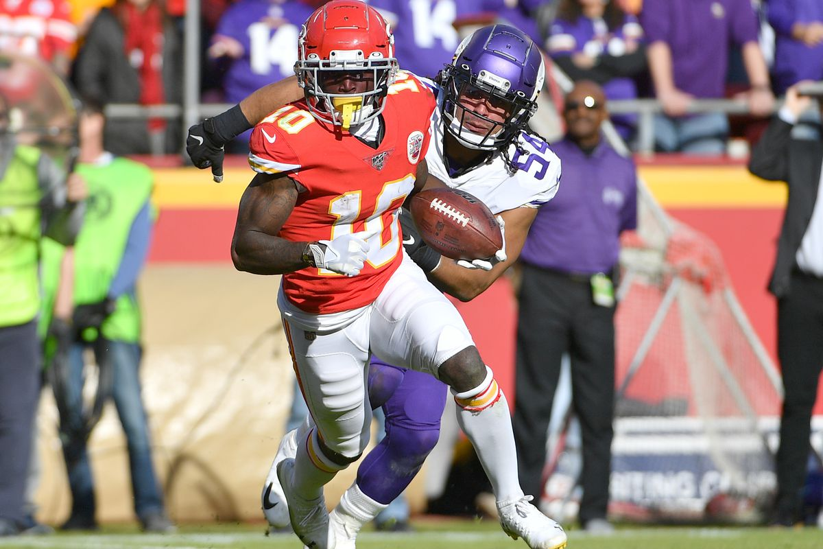 Kansas City Chiefs wide receiver Tyreek Hill runs the ball as Minnesota Vikings middle linebacker Eric Kendricks chases during the game at Arrowhead Stadium.