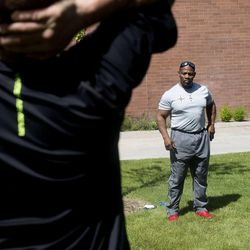 Ron Williams, center, a nondenominational Christian pastor, leads an exercise group of Utah National Guard members at their headquarters on Thursday, Aug. 14, 2014.