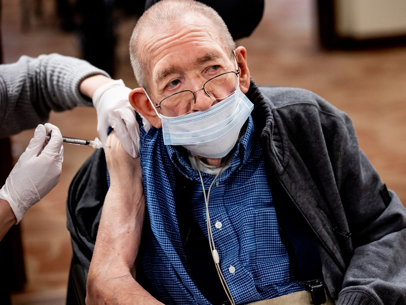 Herald Johnson, 89, receives his second dose of the Pfizer-BioNTech COVID-19 vaccine at The Lodge at North Ogden on Thursday, Feb. 11, 2021.