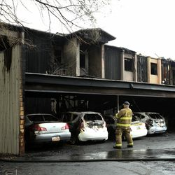 South Salt Lake firefighters clean up after an early morning fire at an apartment complex near 3300 South and 350 East in South Salt Lake on Thursday, April 16, 2020.