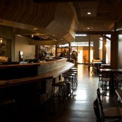 Wylie Price designed the interesting soffit above the bar.