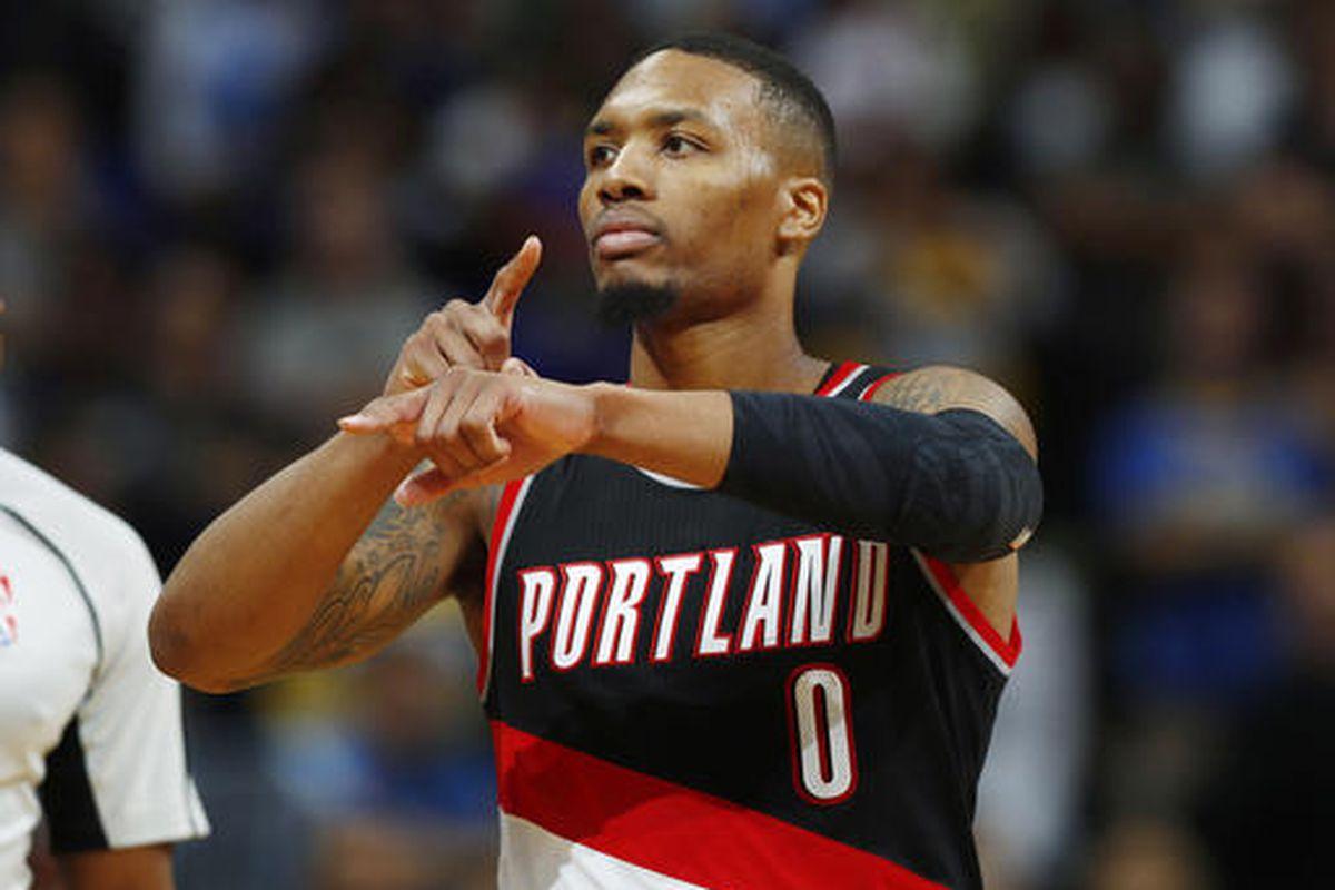 Portland Trail Blazers guard Damian Lillard gestures after hitting the winning basket.