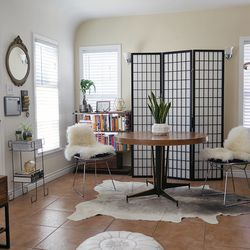 DeLucia suggested I move the dining table front and center and  hide the heater with a folding screen. I was skeptical at first; all of a sudden, my tiny living room felt more inviting.
