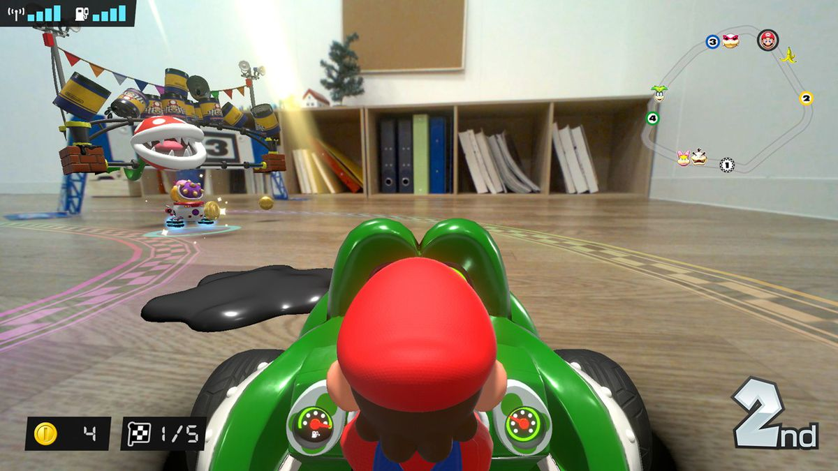 Mario driving through a living room and there are oil slicks in front of him