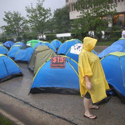 Demonstrators calling for an increase in the minimum wage to $15-an-hour camped outside McDonald's corporate headquarters on May 25, 2016, in Oak Brook, Illinois.   Scott Olsen/Getty Images