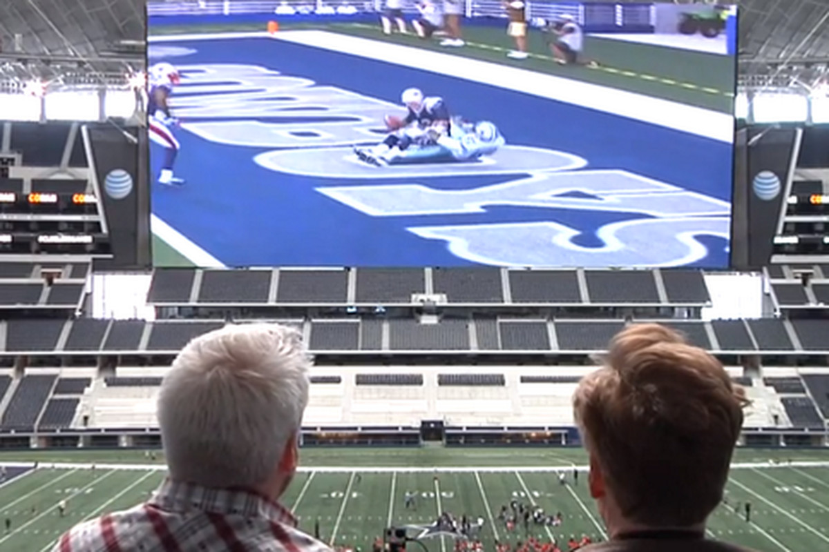 Cowboys owner Jerry Jones (left) and Bengals quarterback Andy Dalton (right) watch a football game.