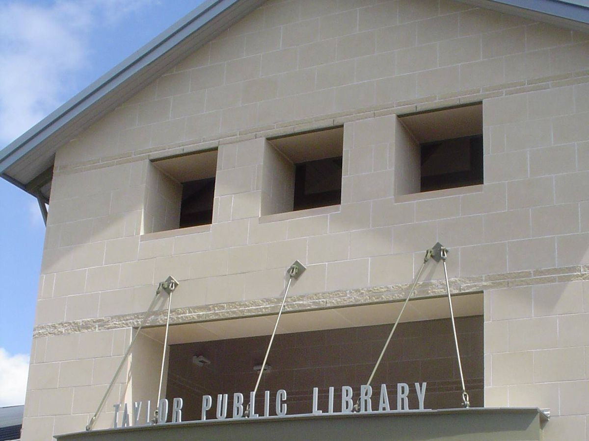 Photo of building front and sign