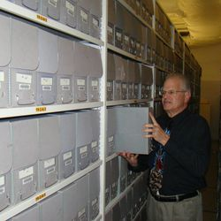 James D'Arc, curator of the Cecil B. DeMille archive at BYU, looks through one of the 1,263 boxes in the collection.