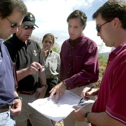 President Mitt Romney and other members of SLOC during a walk-through of the ski jump venue at Utah Winter Sports Park May 24, 2000.