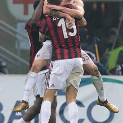 Patrick Cutrone of AC Milan celebrates with his team-mates after scoring the opening goal during the TIM Cup match between AC Milan and FC Internazionale at Stadio Giuseppe Meazza on December 27, 2017 in Milan, Italy.