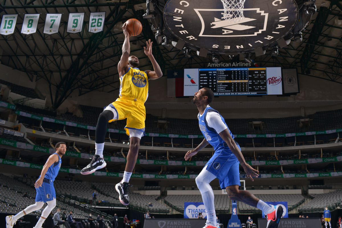 Andrew Wiggins #22 of the Golden State Warriors shoots the ball during the game against the Dallas Mavericks on February 4, 2021 at the American Airlines Center in Dallas, Texas.