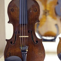 A violin with five Stars of David is on display.