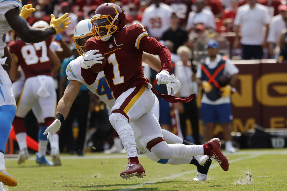 Washington Football Team wide receiver DeAndre Carter (1) returns a kickoff past Los Angeles Chargers linebacker Drue Tranquill (49) in the second quarter at FedExField.