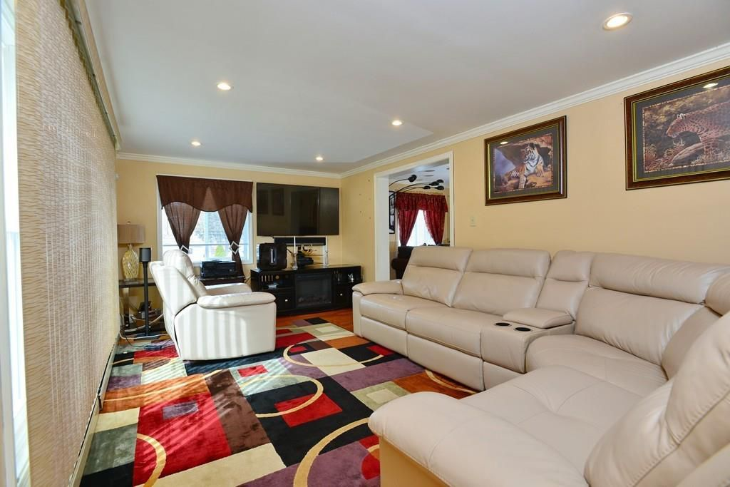 Another living room with a sectional couch.