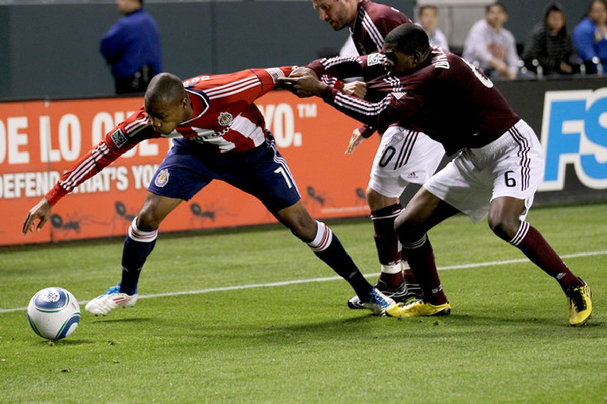 CARSON, CA - MARCH 26:  Anthony Wallace #6 of the Colorado Rapids fights for the ball with Tristan Bowen #7 of  Chivas USA at The Home Depot Center on March 26, 2011 in Carson, California.  (Photo by Stephen Dunn/Getty Images)