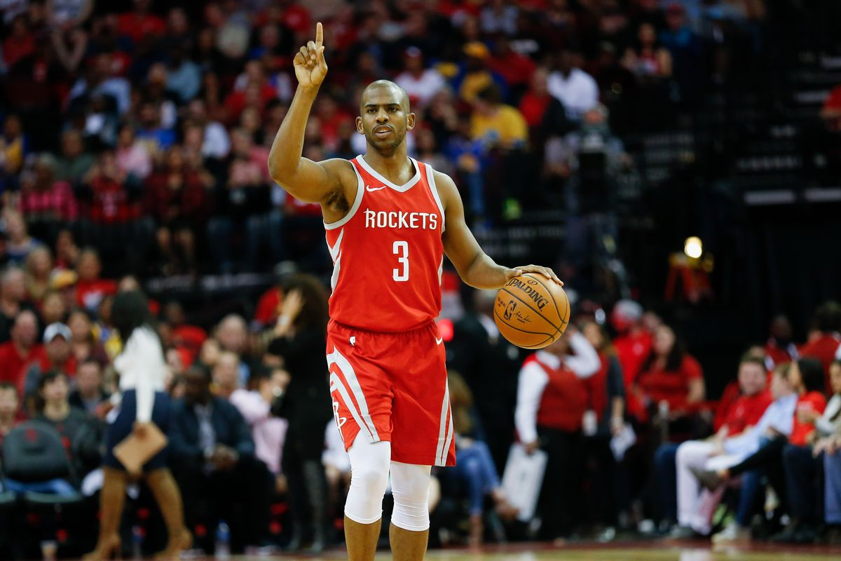Chris Paul dribbling and holding up one pointer finger