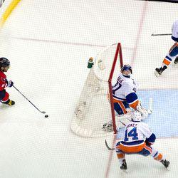 Ovechkin Behind Islanders Net