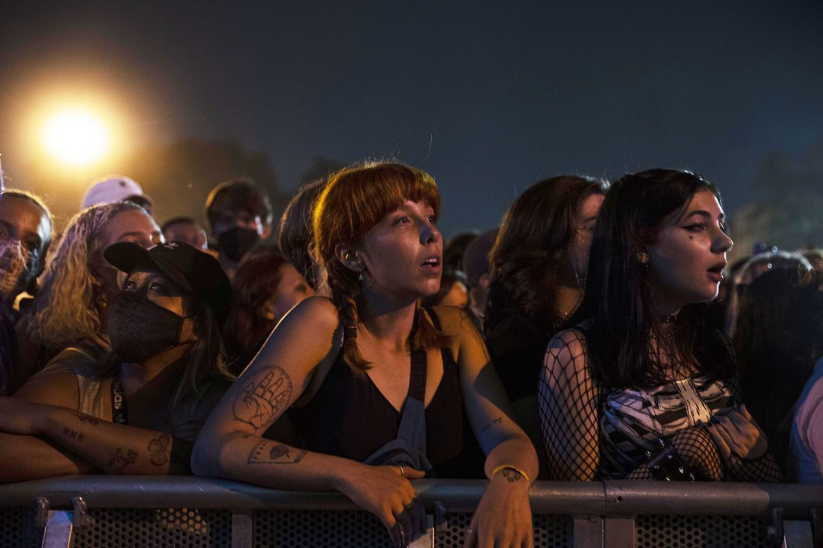 Festival-goers watch Phoebe Bridgers perform on day one.