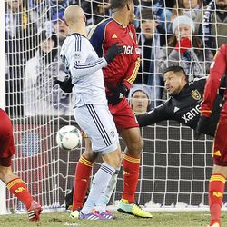 Real's Nick Rimando dives for and misses a shot by Sporting's Aurelien Collin as Real Salt Lake and Sporting KC play Saturday, Dec. 7, 2013 in MLS Cup action. Sporting KC won in a shootout.