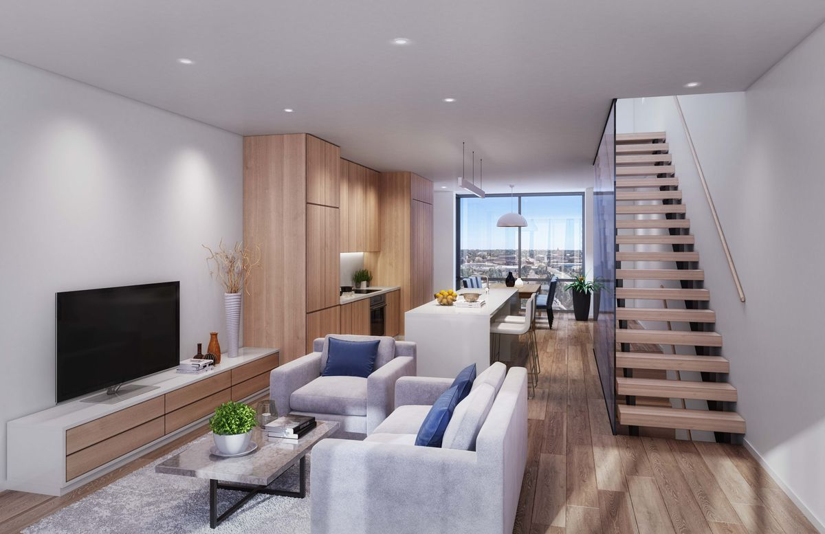 An open floor plan connecting all three parts of the room. There's a white char and love seat across form a flat screen TV.