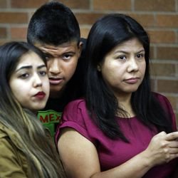 Former student Stephany Mijares, left, her brother, Joseh, and her mother, Violetta, listen during a press conference in Orem on Tuesday, Nov. 15, 2016, after five students were stabbed in an apparent attack by a 16-year-old boy at Mountain View High School.