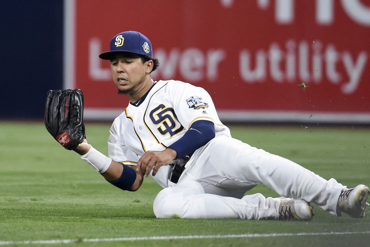 Jon Jay slides to make a catch for the Padres.