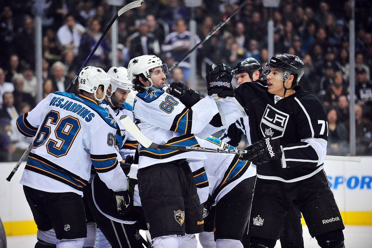 April 5, 2012; Los Angeles, CA, USA; Los Angeles Kings players engage San Jose Sharks players during the first period at Staples Center. Mandatory Credit: Gary A. Vasquez-US PRESSWIRE