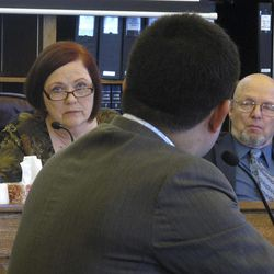 Reps. Bob Herron, Berta Gardner and Alan Dick listen as consultant Janak Mayer testifies before the House Resources Committee and House Special Committee on Energy on Monday, April 23, 2012, in Juneau, Alaska. Mayer testified on the governor's oil tax bill.
