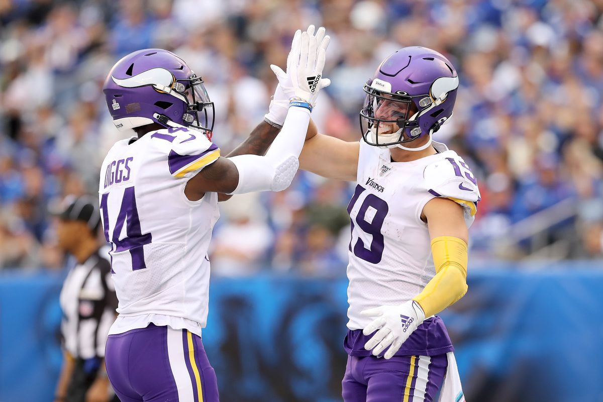 Stefon Diggs of the Minnesota Vikings congratulates teammate Adam Thielen after he scored a touchdown in the third quarter against the New York Giants at MetLife Stadium on October 06, 2019 in East Rutherford, New Jersey.