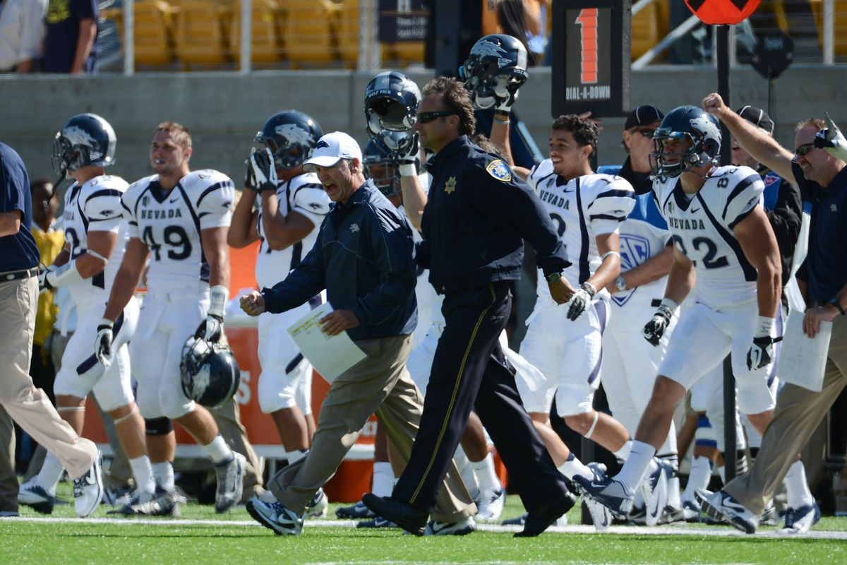 September 1, 2012; Berkeley, CA, USA; Nevada Wolf Pack head coach Chris Ault celebrates after the game against the California Golden Bears at Memorial Stadium. The Wolf Pack defeated the Golden Bears 31-24. Mandatory Credit: Kyle Terada-US PRESSWIRE