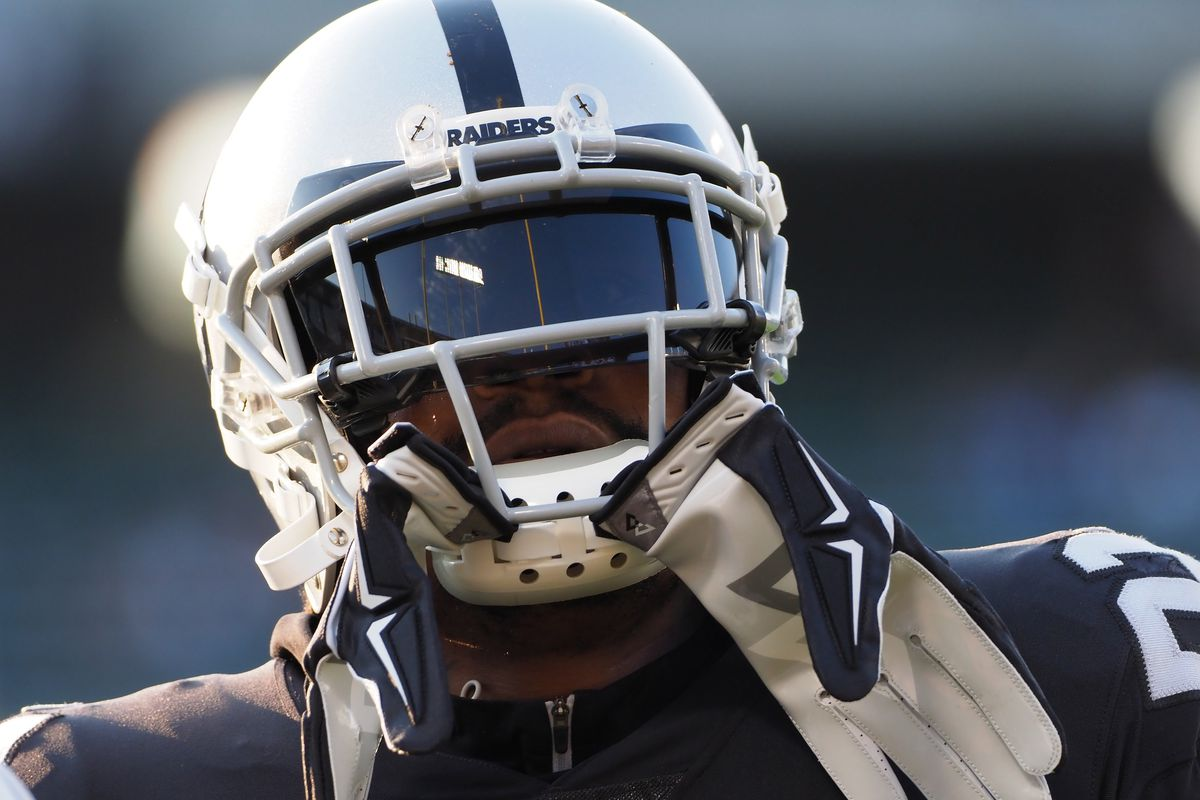 Oakland Raiders running back Marshawn Lynch looks on during warm ups before a game against the Detroit Lions at Oakland Coliseum.