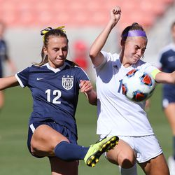 Bonneville's Sadie Beardall kicks the ball away from Skyline's Lilly Kimball as they play in 5A girls soccer state semifinal action at Rio Tinto Stadium in Sandy, Utah, on Tuesday, Oct. 20, 2020. Bonneville won 2-0.