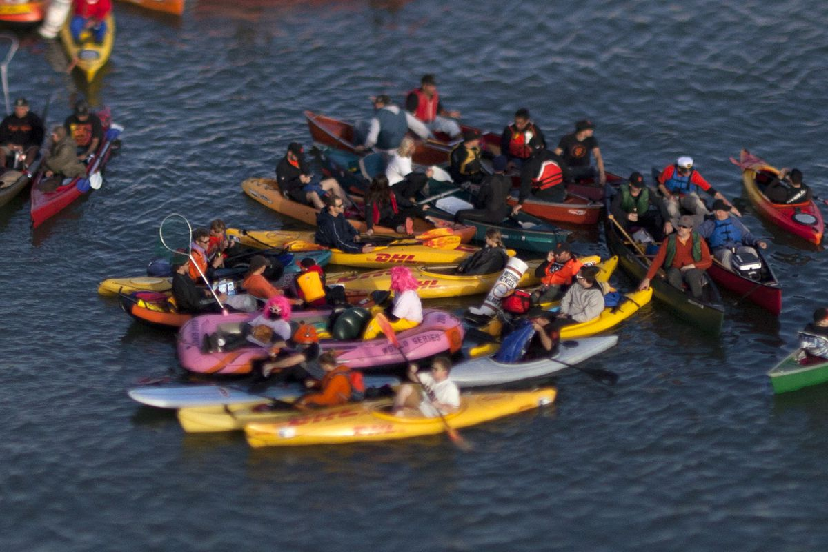 Fans in a variety of watercraft fill McCovey Cove as the San Francisco Giants take on the Kansas City Royals in Game 4 of baseball's World Series at AT&T Park in San Francisco, Calif., on Saturday, Oct. 25, 2014. This photo made with a tilt-shift lens. (P