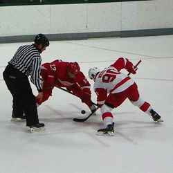 Weiss gets to the puck first........