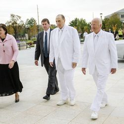 President Thomas S. Monson walks into the temple with his daughter Sister Ann Dibb and Elder Kent F. Richards, of the Seventy and director of the church's temple department as they rededicate the Ogden temple Sunday.