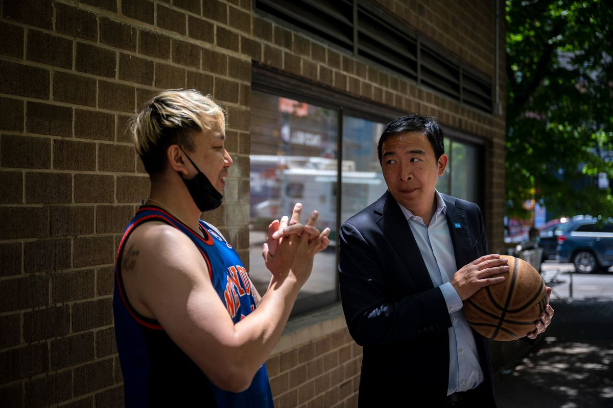 Yang goes one-on-one with a New Yorker in Lower Manhattan., June 18, 2021.