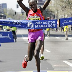 Women's winner Sharon Cherop of Kenya crosses the finish line of the 2012 Boston Marathon in Boston, Monday, April 16, 2012. (AP Photo/Elise Amendola)